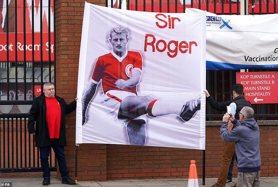 One supporter held up a 'Sir Roger' banner that depicted the striker in his Liverpool kit on an emotional morning in the city