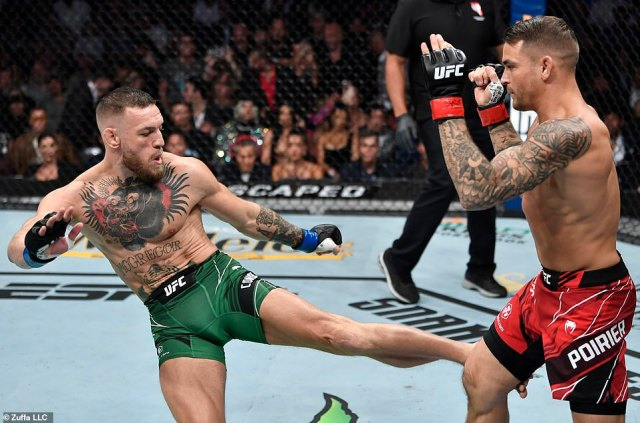 Fighter: He prides himself on being one of the most famous mixed martial artists in the world (pictured fightingDustin Poirier in Las Vegas in July)