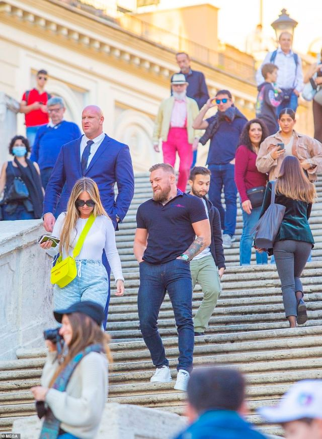 Taking in the sights: Dee and Conor strolled down the Spanish Steps as they headed to the various tourist attractions