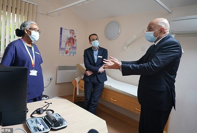 Health Secretary Sajid Javid has defended his plans for improving access to GPs. Patients will now be able to demand face-to-face appointments, with surgeries only able to refuse if there is a good medical reason (Pictured: Javid attends a surgery in south-east London today)