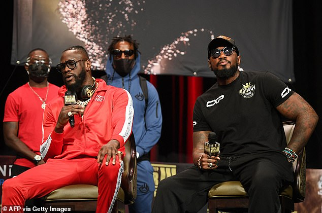 Wilder's trainer Malik Scott (right) admitted his fighter was simply beaten by the better man