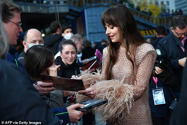 Meet and greet: Dakota Johnson delighted fans at the London premiere of her film The Lost Daughter at The Royal Festival Hall on Wednesday night