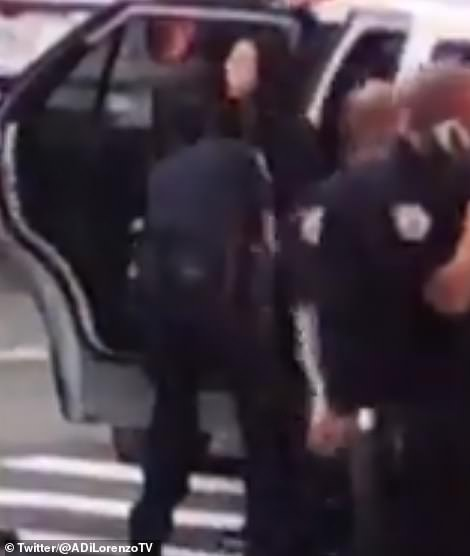 This is the moment Wu was cuffed and taken in a police car to the hospital to undergo evaluation