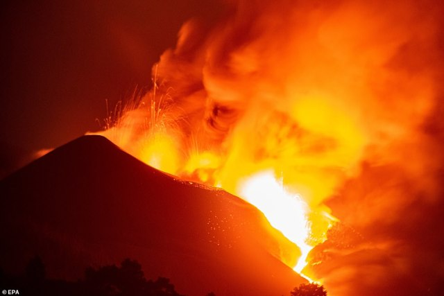 Lava from the volcano illuminates the sky in the early hours of Thursday morning - the 25th day since eruptions began