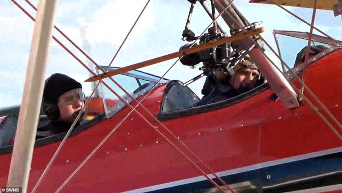 Taking to the Skies: Tom was joined at the airfield by the film crew, who rigged their Model 75, which was once used to train US Air Force and RAF pilots with two film cameras.