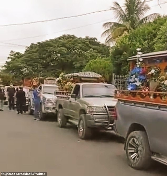 Vehicles line up with the caskets containing the bodies of four Salvadoran migrants who were killed Sunday in La Libertad, Salvador.