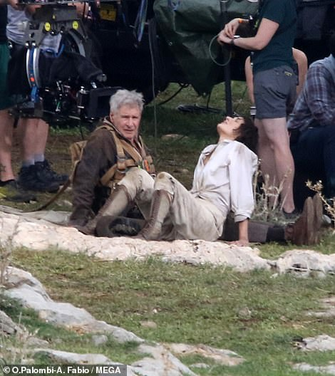 Thirsty work!  While in Sicily, the Fleabag star, 36, was seen dragging Harrison, 79, out of a ditch before collapsing from exhaustion with him in the mud