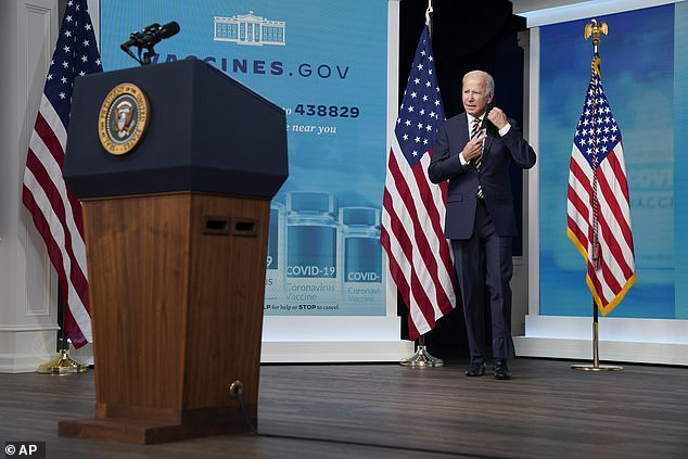President Joe Biden takes off his mask as he gives a short speech Thursday from the South Court Auditorium
