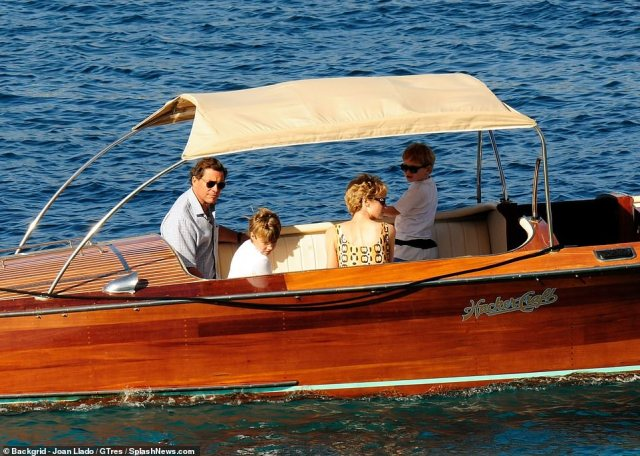 Sunny! All four actors opted for sunglasses when sitting on the luxury boat in the Spanish island ofPalma de Mallorca