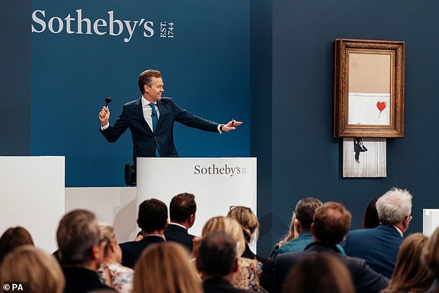 , Banksy artwork sucked into concealed shredder is bought for £18.6million, The Today News USA