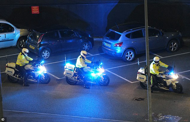 The PM's convoy pictured after he landed at London's Heathrow Airport this evening