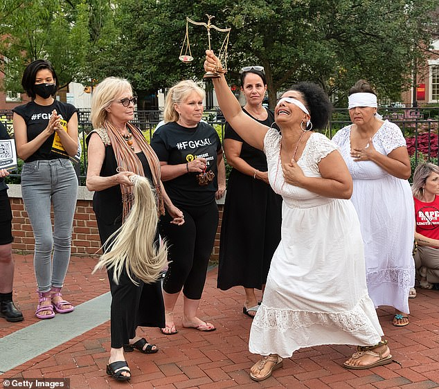 Bernard, right, dressed as Lady Justice during a protest against the overturning of Bill Cosby's 2018 sexual assault conviction