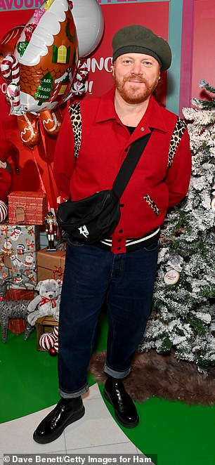Inspired by Santa: Keith looked festive in a red jacket