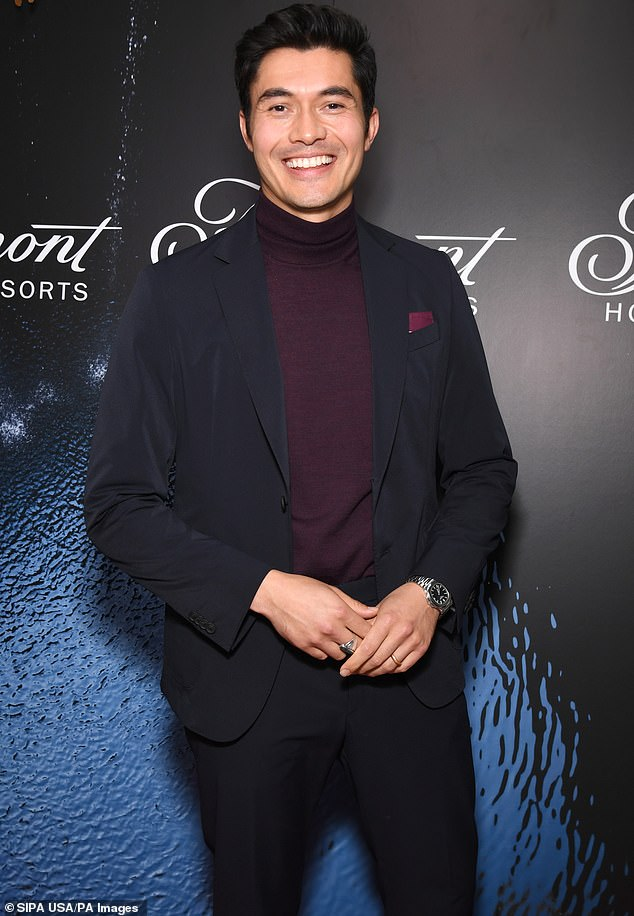 Looking fab:The 34-year-old film star went for a 1960s chic combo of a royal purple turtleneck and a black suit, complete with a purple pocket square