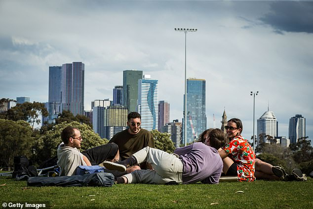 Fully vaccinated Melburnians will be able to able outdoors in groups up to 15 (pictured Victorians having a picnic in Princes Park)