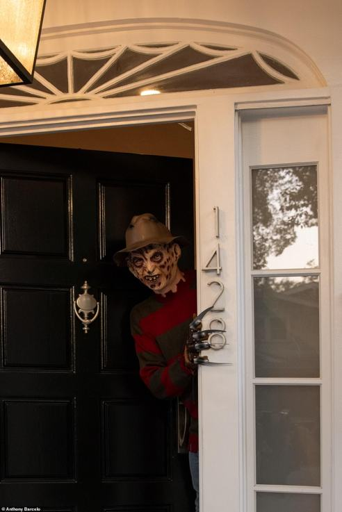 Hey! The iconic character pokes his head out of the front door to greet guests