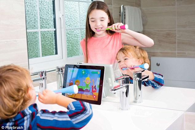 Playbrush aims to encourage children to brush their teeth by transforming a toothbrush into a gaming controller. A device on the end of the toothbrush connects to a game app, as pictured