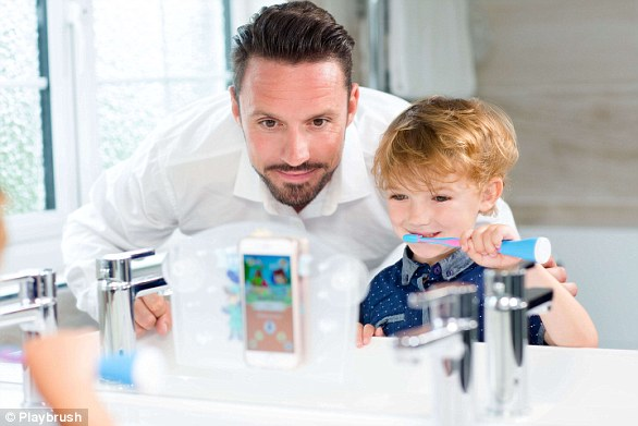 The toothbrush connects via bluetooth to a games app that can be played on either a phone or an iPad, which can be attached to a bathroom mirror for ease, pictured. The game is controlled by the movement of the child's toothbrush and built-in motion sensors measure toothbrushing positions, speed and duration