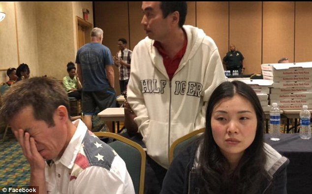 Peter's distraught parents are pictured waiting for news at the Marriott hotel where missing students' relatives were told to gather last week