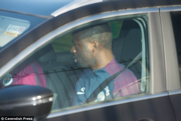 Yaya Toure avoids the gaze of the camera as he is driven into the Etihad Campus on Tuesday