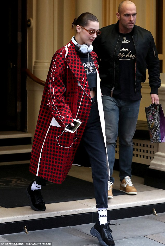Stepping out: The model was in high spirits as she exited her London hotel