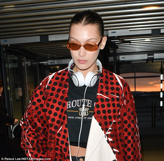 Striking:The American model ensured all eyes were on her as she made her way across the terminal while preparing to catch a flight to Milan