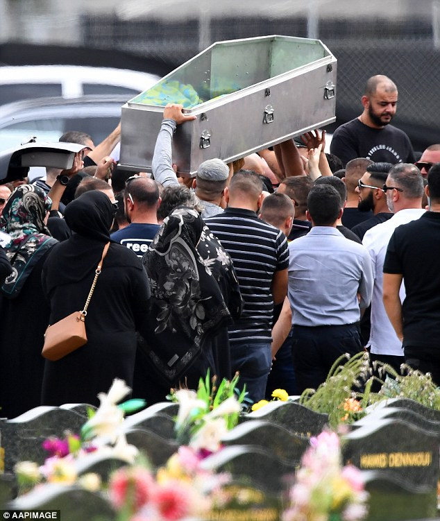 Hawi's body of was taken out of a coffin and placed into a grave, as hundreds of mourners watched on in Sydney's south last month