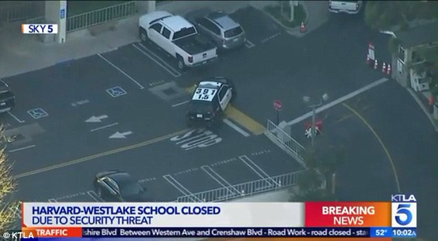 A spokesperson for LAPD told DailyMail.com: 'There was a post on social media and for precautionary measures they added extra patrols to the school.' Pictured: The scene at the high school on Friday