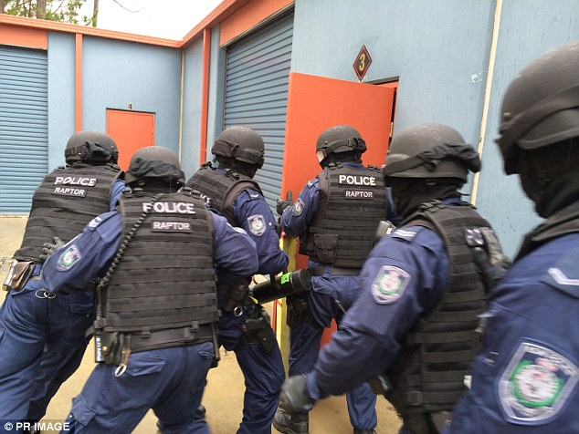 The anti-bikie Strike Force Raptor raids a Comanchero clubhouse on the NSW Central Coast