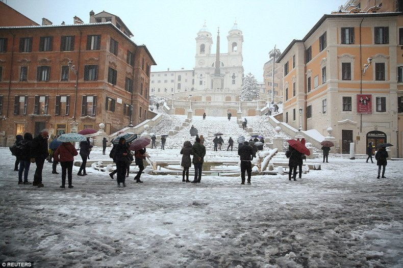 The residents of Rome are seen in front of the Spanish Steps to enjoy the unusual weather in the Italian capital