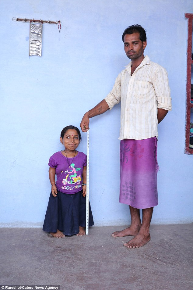 Strangers mistake Miss Kumari, who is just 83cm (33in) tall, for a preschooler because of her tiny limbs and pint-sized frame (pictured with her brother)