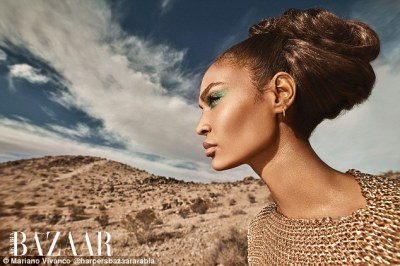 Gorgeous woman: The supermodel highlighted her striking features with deftly touches of make-up, accentuated with glittering green eye shadow