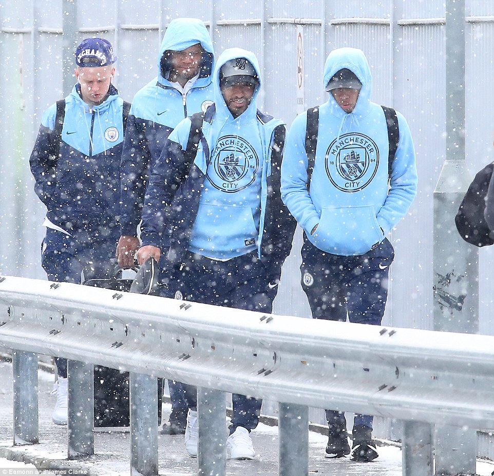 (Left to right) Oleksandr Zinchenko, Vincent Kompany, Sergio Aguero and Gabriel Jesus wrap up against the cold