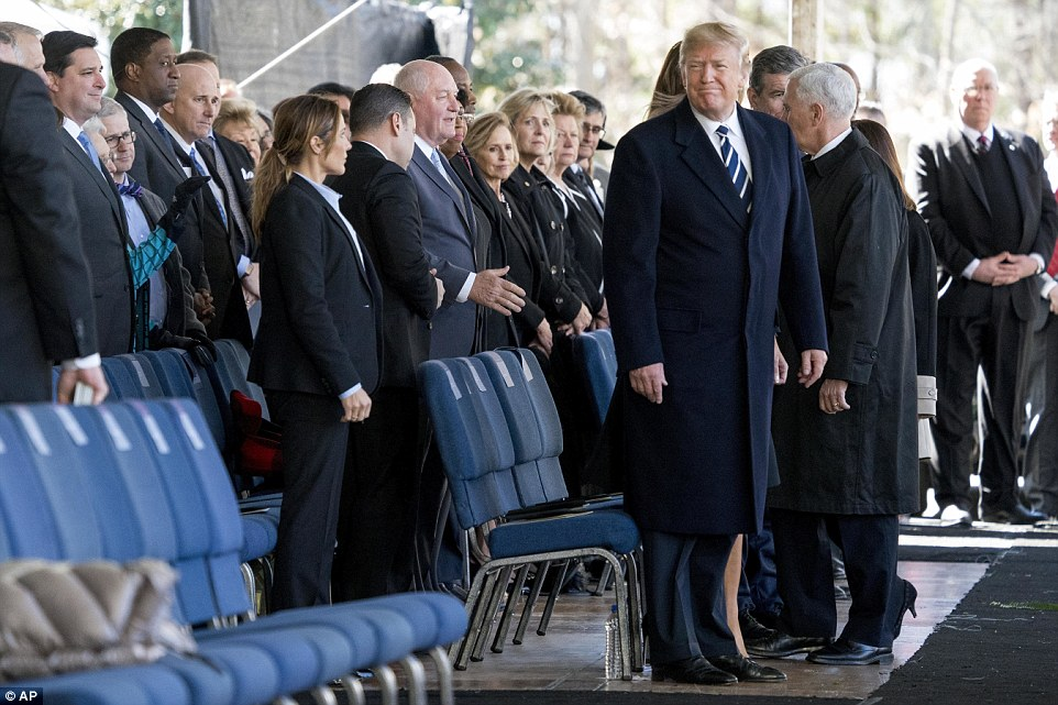 Leaders take their seats:President Donald Trump and Vice President Mike Pence arrive at the service after speaking with the Graham family