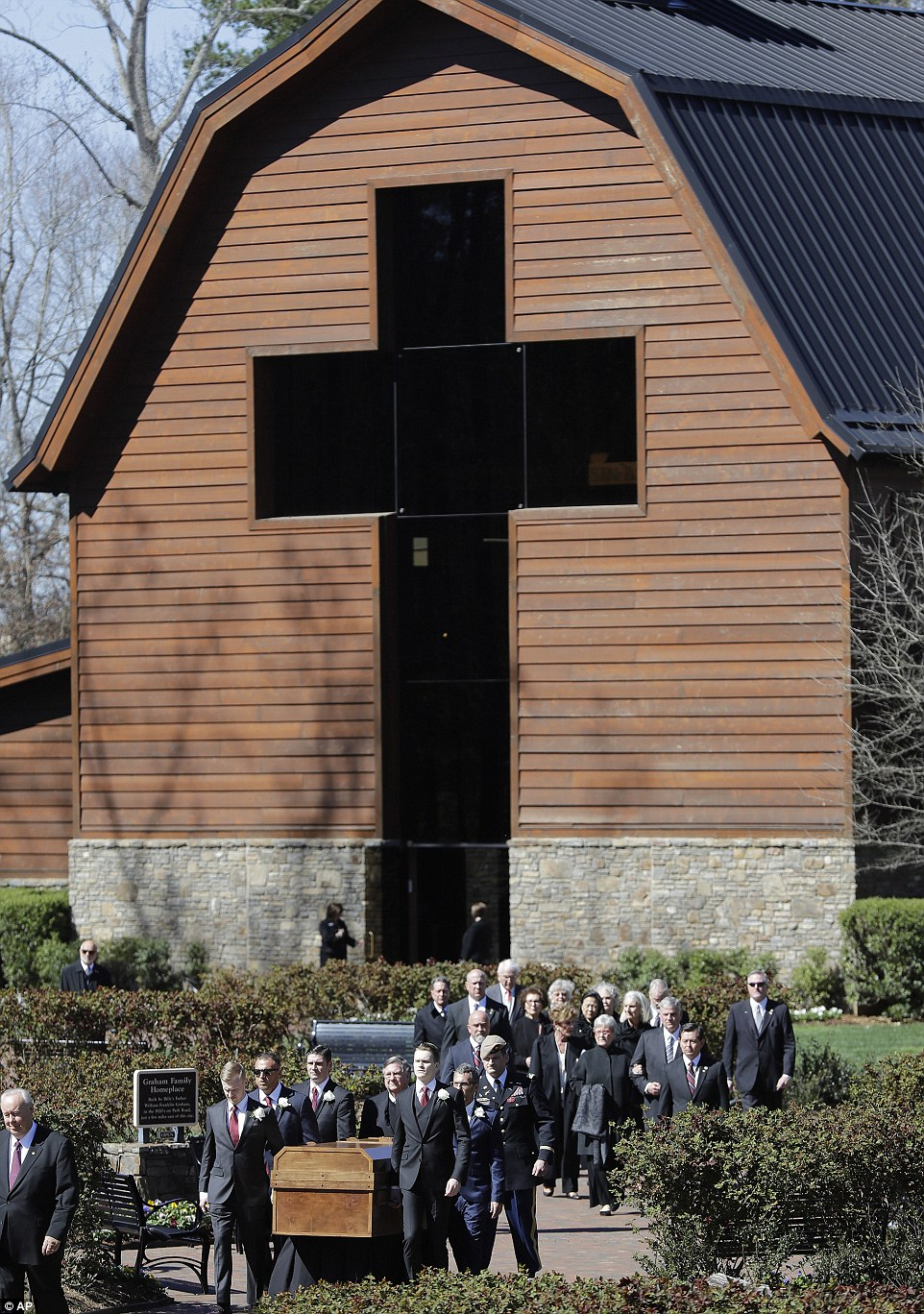 Heading to the tent:The casket of The Rev. Billy Graham is moved during a funeral service at the Billy Graham Library
