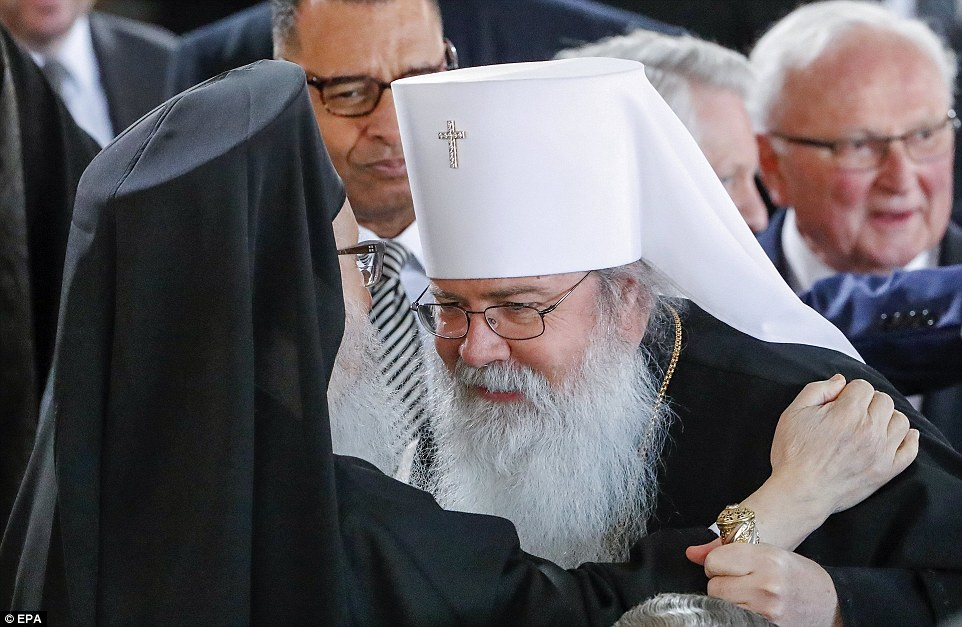 Paying respect: Religious leaders from all faiths gathered at the service on Friday (above)