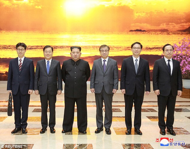 North Korean leader Kim Jong Un meets members of the special delegation of South Korea's President in this photo released by North Korea's Korean Central News Agency