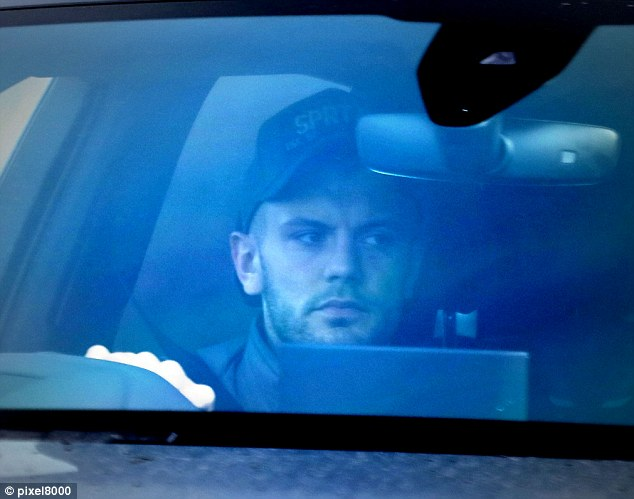Arsenal and England midfielder Jack Wilshere arrives at training ahead of Tuesday's session