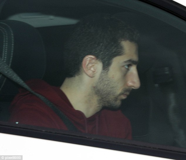 Henrikh Mkhitaryan looks less than delighted as he makes his way into Arsenal's training HQ