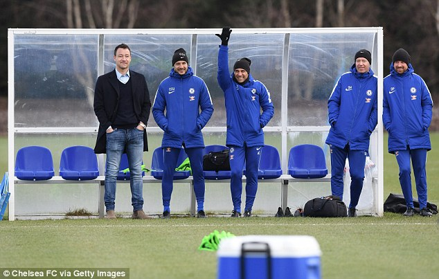 The former Chelsea defender watched on as his former team-mates trained in Cobham