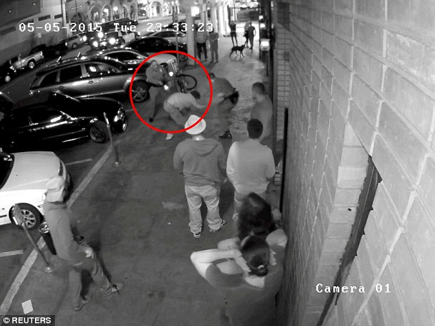 The 29-year-old of Troy, New York, was on his stomach and trying to push himself up when Proctor shot him twice in the back, according to police (pictured). A police report said Proctor told investigators that he saw Glenn's hand on his partner's holster and thought he was trying to grab the other officer's gun