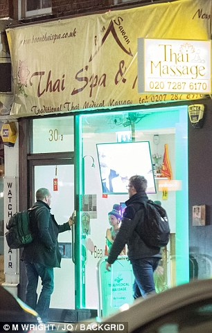 The Harry Potter actor was seen going into the massage parlour at 10.45pm (above left)