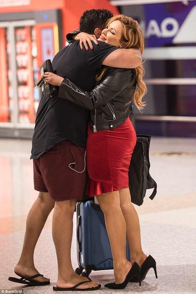 Reunited! Married At First Sight's Telv Williams, 33, and Sarah Roza, 38, were spotted putting on a passionate display at Melbourne Airport on Monday