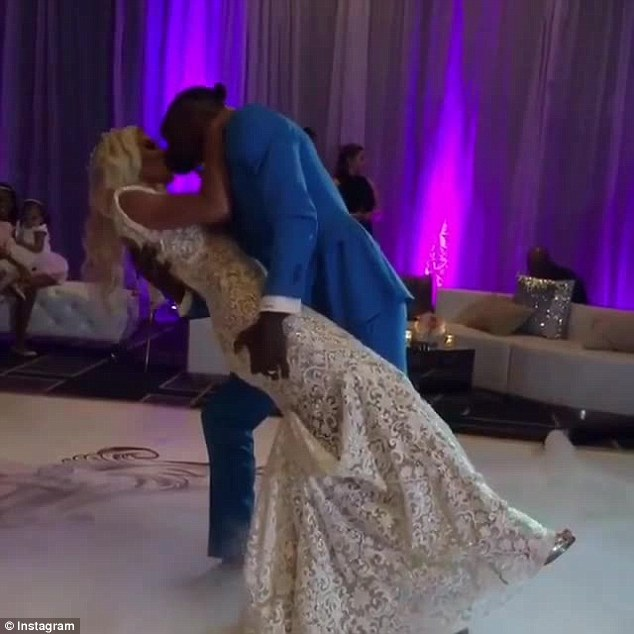 And here it goes: The football star dipped his new wife as he planted a kiss on her lips