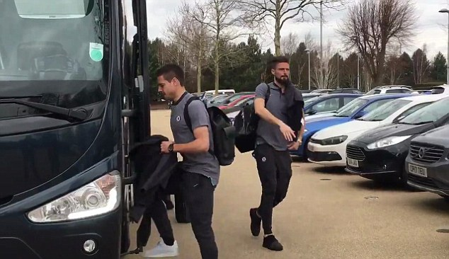 The Spaniard climbs aboard the coach as team-mate Giroud moves to greet the staff member