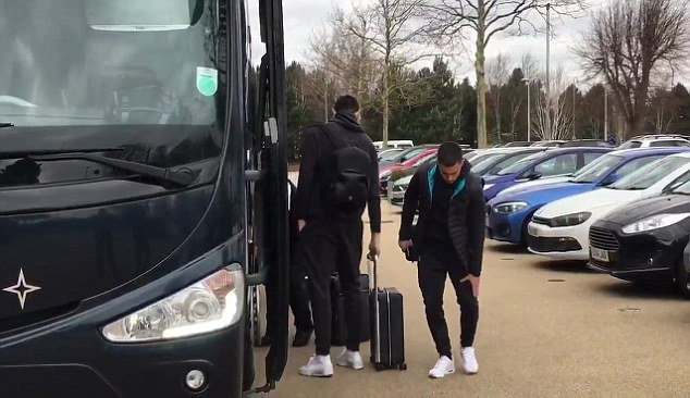 The Belgian holds his upper-left thigh as he prepares to climb on to the club coach
