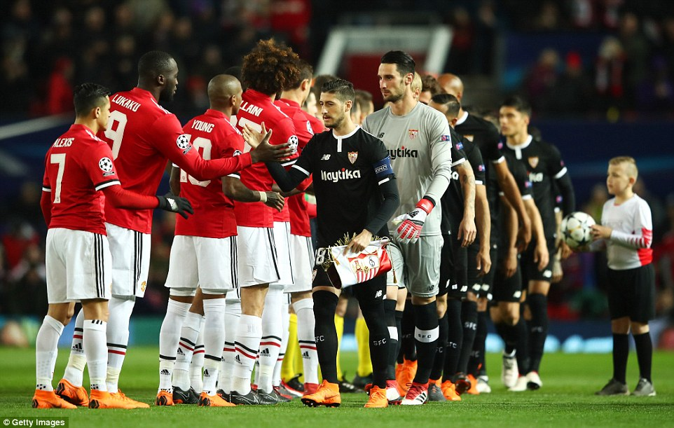 The two teams shake hands and greet one another in the build-up to the encounter at Old Trafford on Tuesday evening