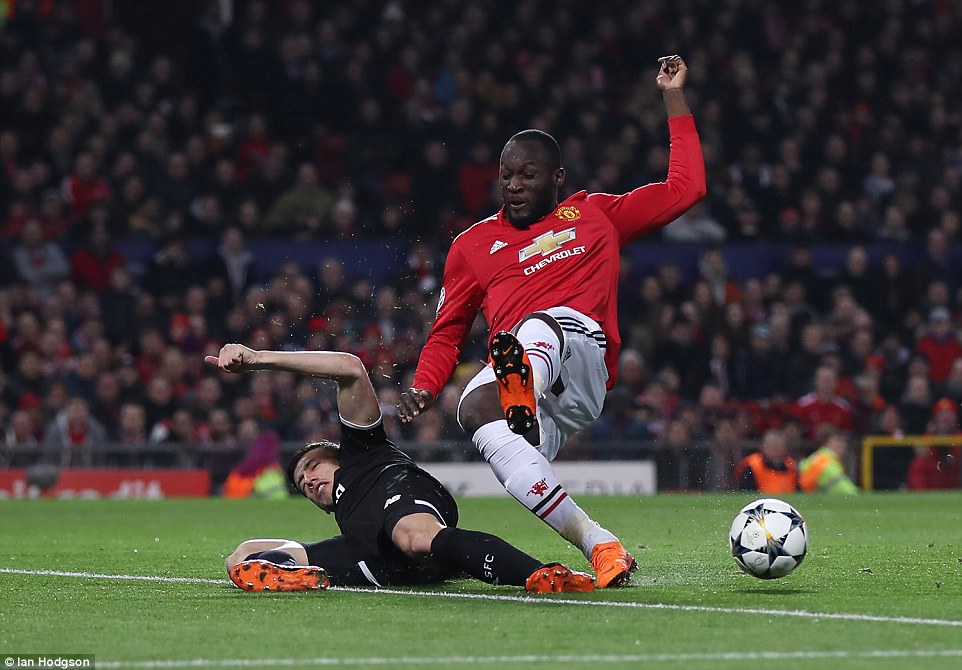 United's Belgian striker Romelu Lukaku is tackled by Sevilla defender Clement Lenglet during a back and forth first-half