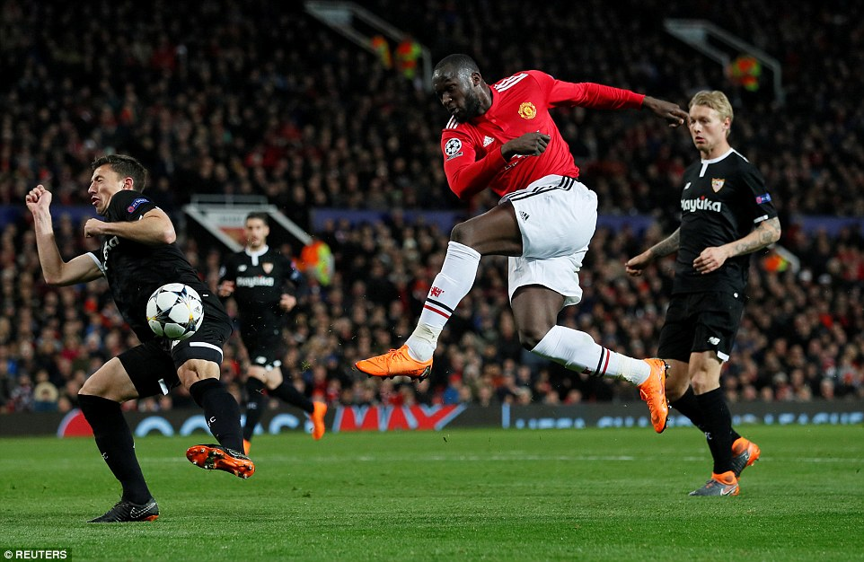 Lukaku attempts to volley the ball towards goal using his left foot but is met by some staunch defending from Sevilla