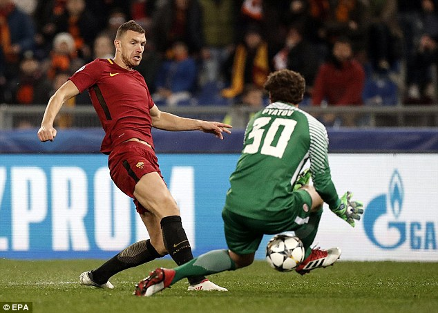 Edin Dzeko slots the ball past Andriy Pyatov to score the winner against Shakhtar Donetsk